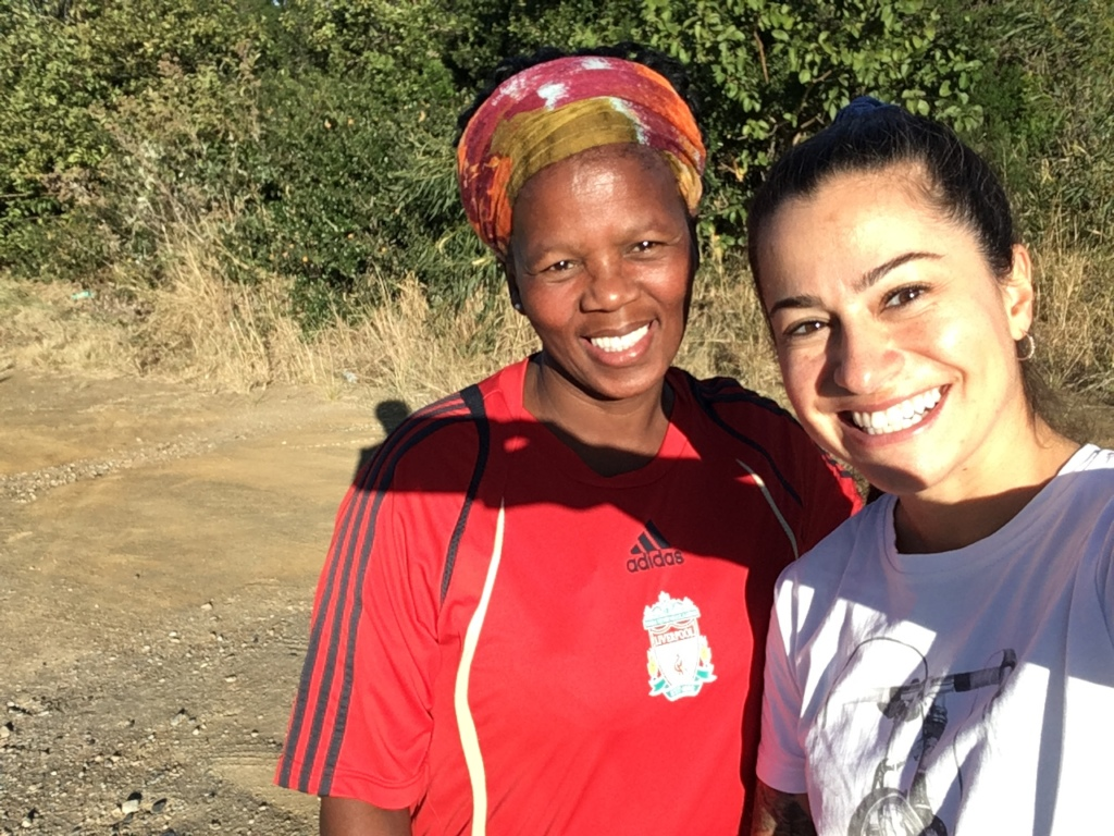Mirian from CVC runs with Pumla from the Angels