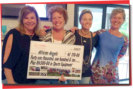 Wild Women on the Run cheque handover to African Angels